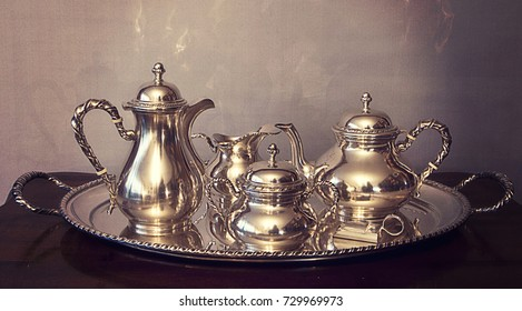Vintage silver coffee and tea set composed by coffee pot,teapot, creamer and sugar bowl on oval tray in San Marco classical style