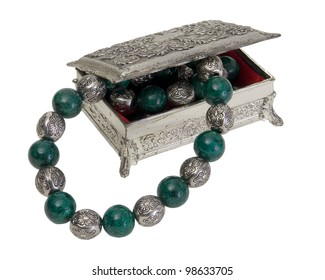 Vintage Silver Finish Jewelry Box with green and silver necklace isolated on white background