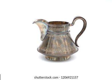 Vintage silver jug on white background. In isolation.
