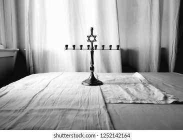 vintage silver menorah on white background, black and white photograph