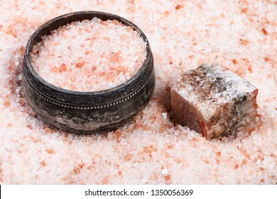 vintage silver salt cellar, rough natural pink Halite mineral and grained Himalayan Salt close up