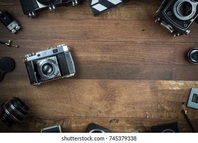 vintage single lens reflex folding camera on a wooden background