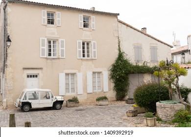 vintage sixties car front of ancient house in ile de re in France Unesco Village