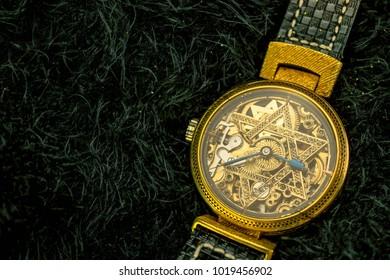 Vintage skeleton watch with Star of David on black fur background