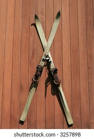 vintage skiis hanging on outdoor wall