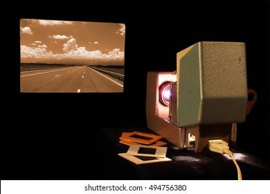 Vintage slide projector in dark room