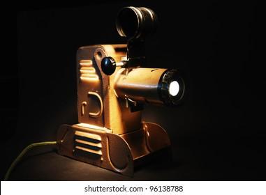 vintage slide projector with the light in dark room