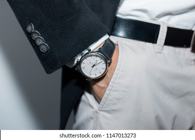 Vintage smart casual outfit outdoor.Fashion model man posing in studio.Suited man posing.closeup fashion image luxury watch on wrist of man.body detail of a business man.