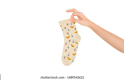 Vintage smelly holey sock object in hand. Woman holding sock isolated on white background and texture. The warm bright socks with clipping path for winter season. Beauty and fashion hipster concept.