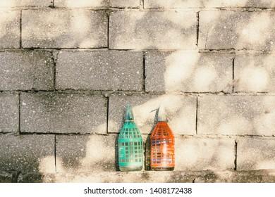 Vintage soda siphones on concrete brick wall