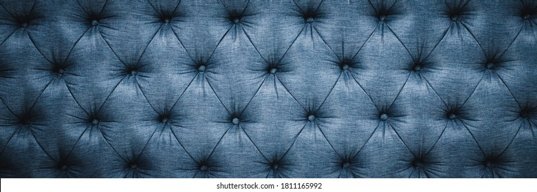 Vintage sofa button backrest of blue in texture. Wallpaper. for pattern and background. banner copy space.