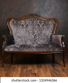 Vintage sofa in a dark room