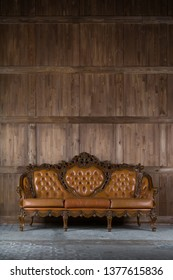 Vintage sofa near wooden wall