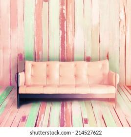 vintage sofa on vintage wooden  wall