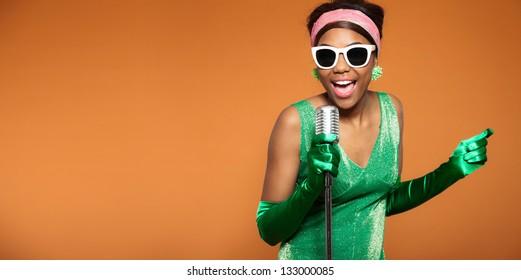 Vintage soul funk woman singing. Black african american. Copy space.