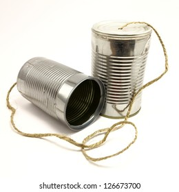 Vintage soup can telephone toy connected with old twine on white background