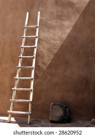 Vintage southwestern ladder against an adobe wall