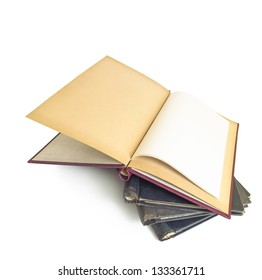 Vintage stationery - a stack of old hard-cover, spring back binders isolated on a white background. Top binder lies open to show a blank first page.