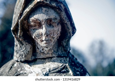 Vintage statue of sad woman in grief. Religion, faith, suffering, love concept.
