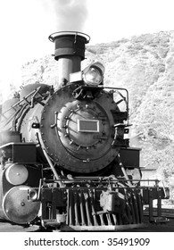 Vintage steam driven engine in black and white