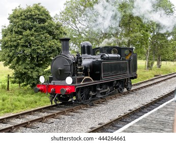 Vintage steam engine or locomotive; steam engine stationary in countryside