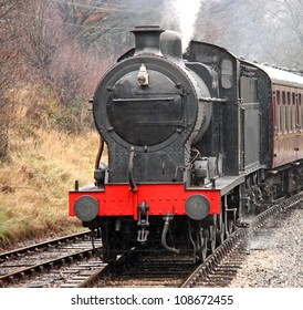 A Vintage Steam Engine Pulling Traditional Carriages.