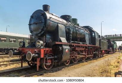 vintage steam engine train on sunny day