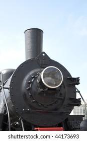 Vintage steam locomotive. Ancient train with a steam locomotive.