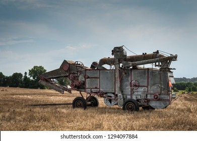 Vintage Steam Thresher in Cut Field
