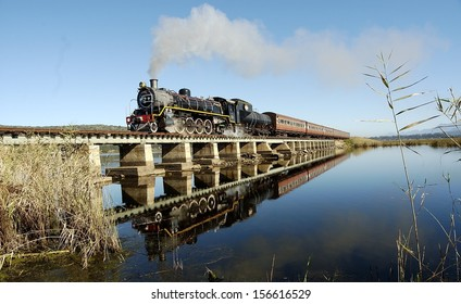 Vintage steam train on a bridge Traveling Between George And Knysna, Garden Route, South Africa