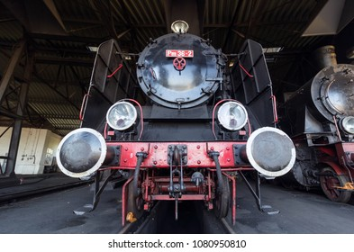 vintage steam train in roundhouse