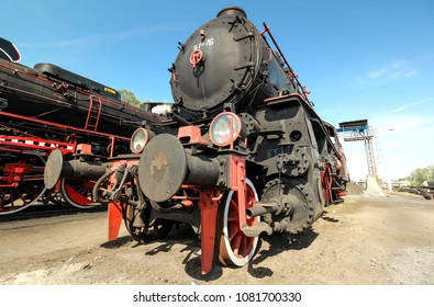 vintage steam trains on blue sunny day