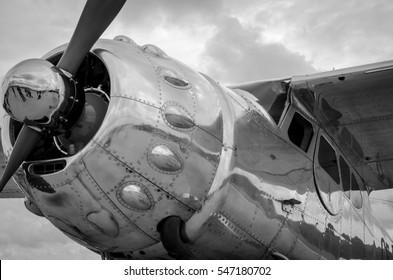 Vintage steel propeller plane polished up at air show shot in black & white
