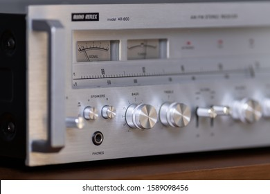 Vintage Stereo Receiver Audio Reflex Front Panel Controls, standing on the Wooden Sideboard