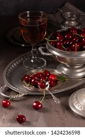 Vintage still life with cherry and pewter