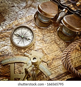 vintage still life with compass,sextant and old map .map used for background is in Public domain.