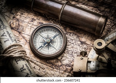 vintage  still life with compass,sextant spyglass and old map.map of the 1570. Author: Abraham Ortelius (1527-1598)