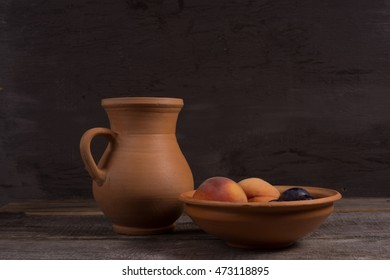 Vintage still life with peach and plums