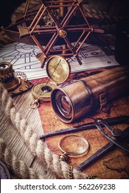 Vintage still life. Travel geography navigation concept background. Old vintage retro compass and spyglass on ancient world map
