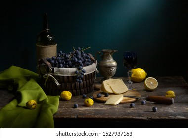 Vintage still life with wine, grape and cheese