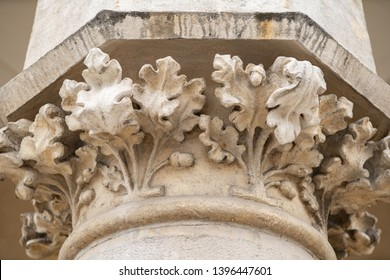 Vintage stone column with decor.Classic roman columns in building exterior in old city of Krakow,Poland.Ancient buildings details in close up.Beautiful old European architecture