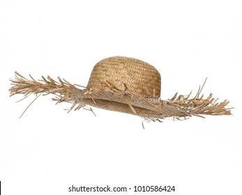 Vintage straw beach hat hat, isolated on white background.  Side view. Tilted up a little, showing the interior.