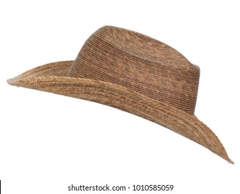 Vintage straw latin american cowboy hat isolated on white background.  Side view.