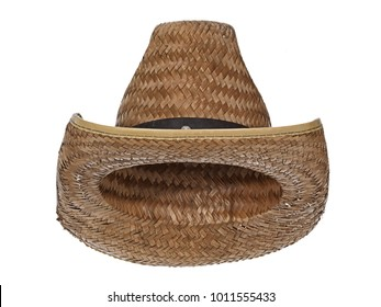 Vintage straw latin american cowboy hat, isolated on white background. Straight front view. Tilted up a little, showing the interior.