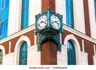 Vintage street clock hanging on a corner of brick building in Samara, Russia