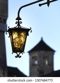 vintage street lamp with bell tower in the background