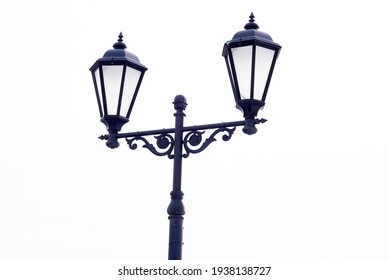 Vintage street lamp isolated on white background. Close-up