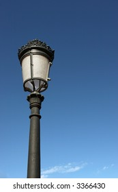 a vintage street lamp photographed against a beautiful blue sky, with copy space
