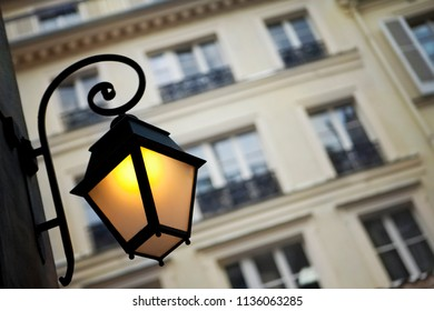 Vintage street lamp and typical facade in Paris