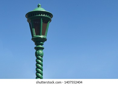 Vintage street lamppost on blue mneb background with space for copy space
